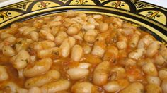 Make these stewed white beans as spicy as you like. Tomatoes, olive oil and Moroccan spices blend together to form a tasty, zesty sauce for this vegetarian dish.