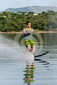 Photo about Mature male water-skiing slalom single ski on glass mirror waters. Image of image, action, colors - 34206619 Skiing, Water, Fun, Image, Mirror, Glass, Internet, Travel Trailers, Mountains