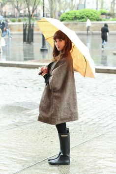 Alden Wicker of EcoCult wears a Victoria Road cape, Alice & Whittles boots, Swedish Stockings tights, and a Pelcor umbrella