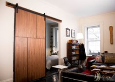 Sliding hardware saves space in this New York apartment