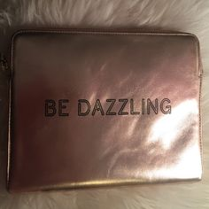 Kate Spade Be Dazzling iPad sleeve Neon sign style script gilds a soft and sturdy sleeve that keeps your iPad safe from scratches. Fits iPad 2 and 3 with Retina Display. Zip around closure. Italian Metallic Leather. Never used. A few very slight scratches. kate spade Accessories Tablet Cases