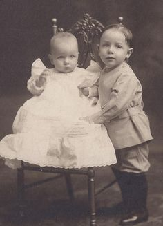 Brother and sister... maybe was not uncommon for baby boys to be put in dresses.