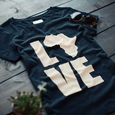 Our 'LOVE Africa' shirt is truly a symbol of change. Each product is hand-signed by the woman who made it.