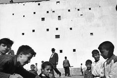 Henri Cartier-Bresson with Le Corbusier architecture in background (?)