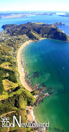 The beautiful Long Beach at Russell in the Bay of Islands. The Bay of islands is home to 144 Islands and laced with pristine beaches like this.
