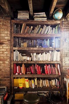Paul you can buy books from second hand stores on interesting subjects and cover them in a color  per subject. rustic shelves with book organized by color