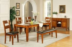 Roanoke Dining Sets.  Welcome to the new transitional style of furniture – with a touch of mid-century modern – shown in this eco-friendly dining set.  Available at Just Cabinets Furniture & More and online at JustCabinets.com