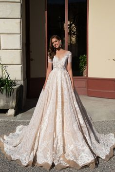 Brenda - White Desire - MillaNova Luxurious wedding gown Brenda totally decorated with delicate lace and made of the finest nude gauze. Short sleeves and deep décolleté emphasize your beautiful neck. Hem falls to the floor. The back of the dress is beautifully buttoned up making accent on your slim waist.