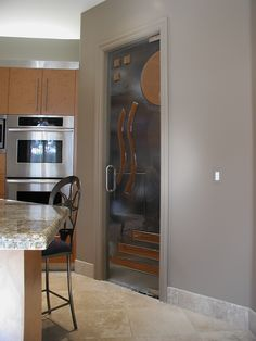 Make your pantry look stunning! This Cast Glass door with Metallicoat™ detail really brings some  artistic aesthetic to the kitchen