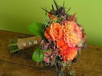 Salmon dahlias, coral and brown, wrapped in burlap - by Robin Wood in Cincinnati