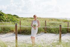 Beach wedding in Miami. Bouquet and photography by Small Miami Weddings. www.smallmiamiweddings.com