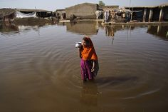 A girl walks through flood waters, the third consecutive year in which millions have been displaced by massive flooding in Pakistan.  The eighteenth United Nations Climate Change Conference, held 26 November to 7 December in Doha, Qatar, aims to achieve accelerated action to curb the increase in greenhouse gases that is threatening the planet. The destructive effects of climate change are felt most acutely by the poorest and will be inherited by all the children of the world.