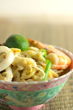 Singapore Hokkien Mee recipe - The prawn stock imparts the essence to the noodle and is the key ingredient that makes the bland-looking dish flavourful.   rasamalaysia.com