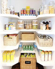 Small U shaped pantry boasts top row lined with flip top jars filled with dried pastas and cereal as well as a 3 tier shelving unit used to house sauces and tuna fish.