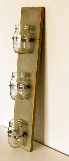 Mason Jar wall vases: vertical or horizontal; -use in laundry room to catch pocket items -use for candles -use by desk to hold pens, pencils, push pins, etc.