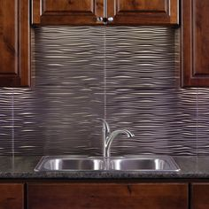 Make waves in your kitchen! FASADE PVC Backsplash Paneling evokes subtle ripples that will enhance your space with modern style and warm colors.