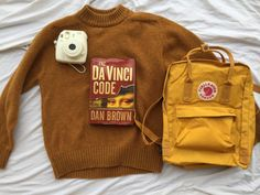MY AESTHETIC!!! DA VINCI CODE THAT HORRIBLE YELLOW THAT I LOVE AND THE POLORID WITH A HUGE SWEATER