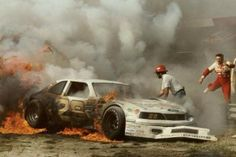 Davey Allison  on fire, Bobby Allison hurdling barriers to get to son.