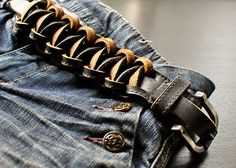 This was made from the creator's husband belt.  Cut it into three strips and did a square knot like used in macreme until the outer two strips were used up.  The center of the belt remained the fasterning part of the belt.