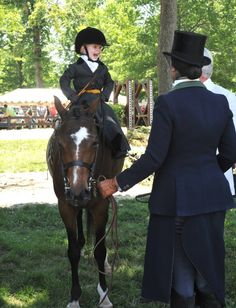 Sydney Pemberton is the excited winner of the Lead Line 3 & under class at Upperville, dressed in full side saddle regalia, as is her lead, Devon Zebrovious. She's having chatting with judge Scott Williamson!