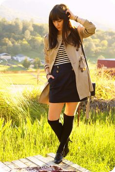 Trench coat with over-the-knee socks. Also, a very nautical outfit (striped shirt, navy blue skirt with sailor buttons).