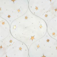 Astronomy, a waterjet stone mosaic, shown in honed Cloud Nine and Brass, is part of the Trove Collection for New Ravenna.