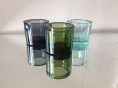 3 candleholders in Different colors Designed by Heikki Orvola in 1988 6 cm tall and 6 cm wide In very good used condition Marimekko is embissed on the base Marimekko, Different Colors, Shot Glass, Candle Holders, Conditioner, Candles, Tableware, How To Make, Etsy