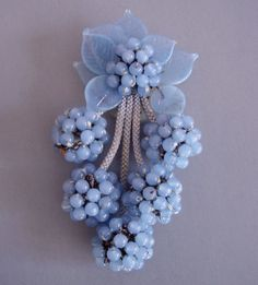 miriam haskell fur clip Beautifull!! I love Morning Glory Jewelry's site. It has a wonderful reference section as well as items for sale. The color of this is so soothing.