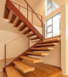 Escaleras flotantes de madera funcionan bien en la mayoría de los hogares modernos