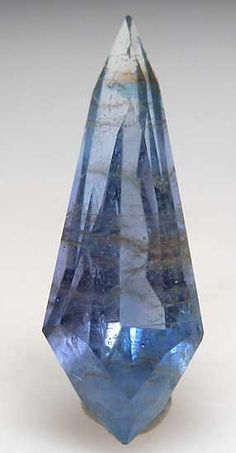 Jeremejevite from Ameib Ranch, Arandis, Erongo Region, Namibia. Etched, gem quality blue crystal with attached Tourmaline paired with a huge 4.48 carat custom cut stone with a good blue coloration. Cut stone is 2cm long. Retail value of the gemstone is $800 per carat ($3,584).