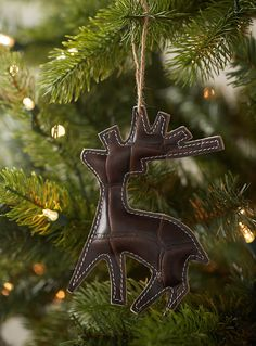 Exclusively from Simons Maison     A rustic chalet-inspired winter decoration, perfect for hanging from the tree   Patchwork-style design crafted from genuine cowhide leather   12 x 14.5 cm
