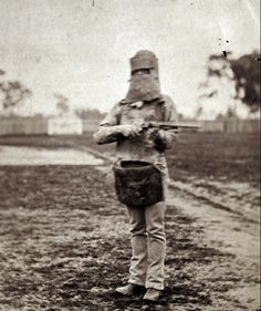 Policeman posing in suit of Kelly Gang armour with Ned Kelly's (the armoured outlaw) rifle and silk cap (June Famous Outlaws, Building A Swimming Pool, Ned Kelly, The Lone Ranger, Old West, Back In The Day, Historical Photos, Vintage Images, Beautiful Landscapes