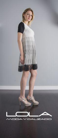 Vas a darle mucho uso a tu vestido de punto, y lo sabes.  Pincha este enlace para comprar tu vestido en nuestra tienda on line:  http://lolamodaycalzado.es/primavera-verano/559-vestido-de-punto-con-rayas-verticales-beige-twin-set.html