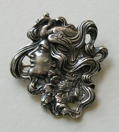 Unger Peacock Lady Sterling Brooch This beautiful Art Nouveau brooch features a lovely lady with a peacock in her flowing hair.