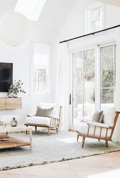 modern meets traditional living room with modern armchair and modern TV console with white rug, neutral living room, white living room decor - Web 2020 Best Site Home Living Room, Living Room Designs, Living Spaces, Living Room Neutral, Bright Living Room Decor, Living Area, Sala Grande, Decoration Inspiration, Decor Ideas