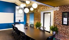 commercial office remodel  #commericial #design #interiordesign #buissness #conferenceroom #hhi #henriettaheisler #chairs #blue #paint #accentwall #meetings #conferencetable #table #plants #lights #painting #accentwall