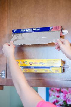 Make rolls of foil and plastic wrap easily accessible. | 12 Ingenious Ways to Organize with Command Hooks