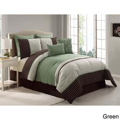 @Overstock.com - Seville 8-piece Comforter Set - This comforter set features a green base with a classy striped printed detail. The soft polyester is machine washable and the set includes matching shams, Euro shams, two decorative pillows and bedskirt.  http://www.overstock.com/Bedding-Bath/Seville-8-piece-Comforter-Set/7866890/product.html?CID=214117 $79.99