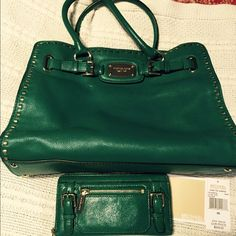 Michael Kors handbag and wallet Green with gold hardware. Only carried once. Wallet and bag look new.  Several compartments.   Lots of room. MICHAEL Michael Kors Bags