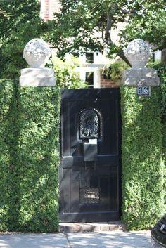 Ivy wrapped plinth columns + black painted gate