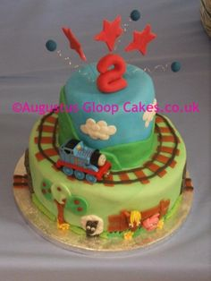 Thomas the tank train cake with tracks and farm animals - This is my thomas the tank cake    www.augustusgloopcakes.co.uk www.facebook.co.uk/augustusgloopchocolatefountain
