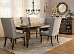 """If you're searching for a dining set with the looks your friends will rave about and the comfort they'll stick around for, you'll love the Kasari. This 7-piece dining set has it all, from the beautiful oak finish to fine details like nailhead trim and turned legs. Six upholstered chairs provide stylish seating, and an 18"""" leaf allows you to extend the table's length to accommodate your guests."""