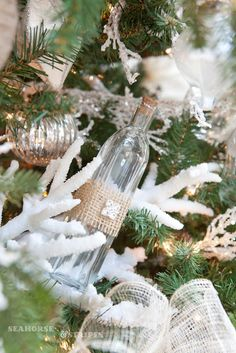 Beachy Christmas Tree + Coral + Little Bottle Ornaments with burlap..I like this..will add a roll up paper for a beach message in a bottle to my tree. Coastal Christmas Home Decor + DIY