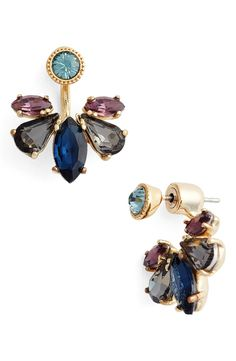 Sprays of shimmering crystals fan out from behind the earlobes in trendy ear jackets that put an ultra-modern twist on vintage-inspired glamour.
