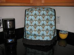 """I like the more designer fabric style of this. (Versus something """"country"""" or such that wouldn't go in my home decor.) Mine is a KitchenAid Classic stand mixer.    This is mine for reference: http://www.amazon.com/KitchenAid-K45SS-Classic-275-Watt-2-Quart/dp/B00004SGFW"""