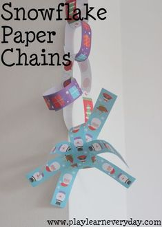 A unique way to make paper chains with snowflake shapes as part of them, as a fun way to decorate for Christmas. Creative Arts And Crafts, Easy Crafts For Kids, Creative Play, Toddler Crafts, Outdoor Activities For Toddlers, Rainy Day Activities, Toddler Learning Activities, Christmas Gifts For Kids, Christmas Crafts
