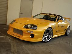 Toyota Supra with Do-Luck kit, wheels, and top secret hood. Side skirts are modified for brake vent.