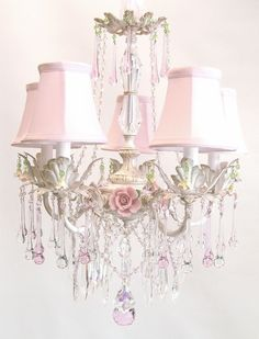Shabby chic chandelier!!! Bebe'!!! Love the pink chandelier with shades!!!