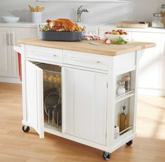 Looking for rolling kitchen cart with dining space like this.  https://www.bedbathandbeyond.com/store/product/real-simple-reg-rolling-kitchen-island-in-white/1041084984?Keyword=kitchen+cart