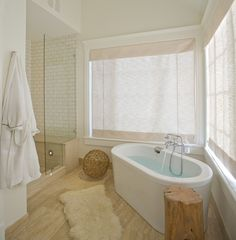 Fantastic modern bathroom design with freestanding oval tub, tree trunk accent table, Ikea Rens pelt, seamless glass shower and subway tiles shower surround. Peach Bathroom, White Bathroom, Modern Bathroom, Earthy Bathroom, Serene Bathroom, Compact Bathroom, Bathroom Bath, Minimalist Bathroom, Bath Tubs